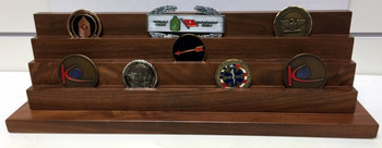 3 tier genuine walnut challenge coin display stand.  Holds 7 each 2 inch coins per tier.  18 inches wide by 4-1/2 inches deep  by 5-1/2 inches high.