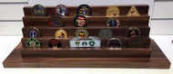 4 tier genuine walnut challenge coin display stand.  Holds 7 each 2 inch coins per tier.  18 inches wide by 5-1/2 inches deep  by 86-1/2 inches high.