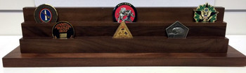 2 tier genuine walnut challenge coin display stand.  Holds 7 each 2 inch coins per tier.  18 inches wide by 14 inches deep  by 4-1/2 inches high.
