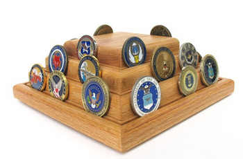 3 tier genuine oak challenge coin display stand. Holds up to forty 2 inches in diameter coins. 6 inches high by 9 inches deep by 9 inches long with rotating base attached.