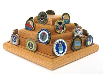 3 tier genuine oak challenge coin display stand pentagon shape. Holds up to forty 2 inches in diameter coins. 6 inches high by 9 inches deep by 9 inches long with rotating base attached.