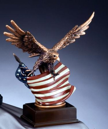 "12"" TALL WITH 12"" WING SPAN BRONZE TONE EAGLE WITH FLAG MOUNTED ON BASE."