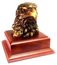 "6-1/2"" TALL EAGLE HEAD, BRONZE TONE MOUNTED ON WALNUT FINISH BASE."