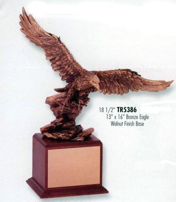 "18-1/2"" TALL BRONZE TONE EAGLE MOUNTED ON WALNUT FINISH BASE."