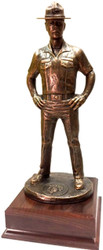 16 inches total height US Marines Drill Sergeant military statue mounted on a 6-1/2 inches wide by 6-1/2 inches deep by 2-1/2 inches high laminated cherry base.  Marine emblem is embossed at the base of this military statue.