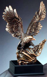 "EAGLE METAL CLAD BRONZE 14"" TALL WITH A 10"" WING SPAN ATTACHED TO BLACK BASE."