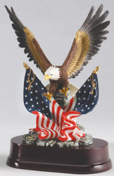 "EAGLE HAND PAINTED 11.0"" TALL WITH TWO FLAGS MOUNTED ON BLACK BASE."