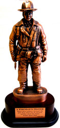 "10-1/2"" TALL BRONZETONE FIREMAN STATUE MOUNTED ON 5"" X 7"" OVAL BASE. TOTAL HEIGHT IS 13-1/4"""