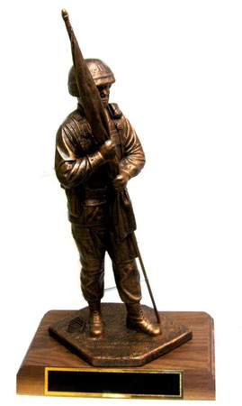 "14"" TALL CSM STATUE ""KEEPER OF THE COLORS"" WITH KEVLAR HELMET MOUNTED ON 8"" X 11"" X 1.5"" GENUINE WALNUT BASE."
