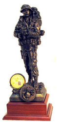 "12"" TALL MARINE RECON MILITARY STATUE MOUNTED ON A 5"" X 5"" X 2-1/2"" LAMINATED WALNUT BASE. SHOWN SAMPLE COIN NOT INCLUDED."