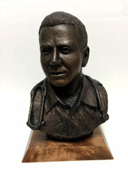 """11"""" HEIGHT MALE NURSE OR PARAMEDIC BUST, BRONZETONE MOUNTED ON 7"""" LONG X 5"""" WIDE X 1"""" HEIGHT SOLID WOOD BASE."""