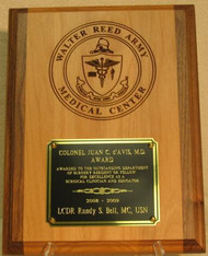 "Original Walter Reed Army Medical Center logo on genuine two tone 9"" by 12"" red alder plaque. Engraving plate is 5"" x 4""."