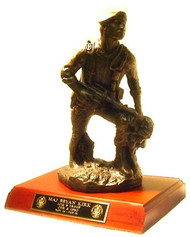 """Romad"" combat military statue 14"" tall mounted on a 8""D x 11-1/2""W x 1-3/4""H genuine walnut base with slanted front."