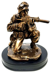 "9"" tall bronzetone military statue of a Soldier kneeling aiming rifle mounted on a black base."