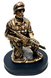 "10"" tall bronzetone Soldier kneeling holding rifle military statue mounted on black base."