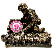 "Soldier medic statue only.  Also available in female version.  6-3/4"" long x 6"" tall x 3-1/2"" deep.  Displayed medallion not included."