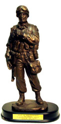 "14"" tall bronze tone Soldier military statue with rifle and holding binoculars, mounted on black base."