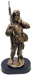 "14"" tall bronzetone Soldier military statue mounted on black base holding a military field phone wearing a radio backpack."