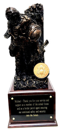"""Awesome military statue of a service member carrying a wounded warrior mounted on a walnut laminated base 6-1/2""""W x 6-1/2""""D x 5""""H.  Total height is 15-1/2"""".  The warrior ethos is shown on the back wall.  Army medallion can be replaced with another service medallion or a unit coin can be mounted instead."""
