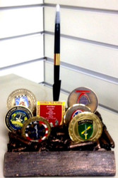 """Resin coin holder with pen.  Accommodates up to 10 each 2"""" coins.    6""""W x 6""""D x 6""""L.  A 5"""" x 7/8"""" engraving plate can be affixed to the front of the coin holder."""