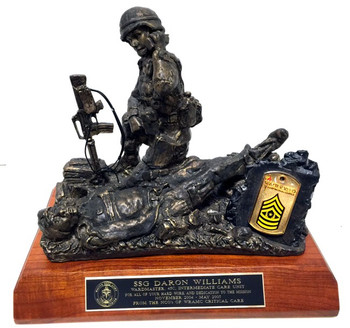 """9"""" tall, 10"""" long, 7"""" wide Female Soldier Medic military statue mounted on a 8"""" x 11"""" x 1-1/2"""" genuine walnut base.  """"Calling Dustoff"""""""