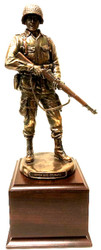 WW II military statue Honor and Courage mounted on a cherry laminated base 5-1/2 inches Wide x 5-1/2 inches Deep x 4 inches Height.  Total height is 15.5 inches. Statue is 11 inches tall.