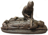 "8-1/2"" tall, 12"" long, 8"" wide Male Soldier Medic military statue with challenge coin slot in front without base."
