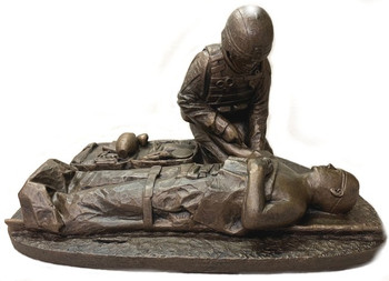"""8-1/2"""" tall, 12"""" long, 8"""" wide Male Soldier Medic military statue with challenge coin slot in front without base."""