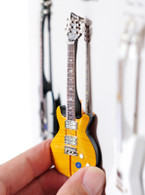 "Rock and Roll History V46 Carlos Santana Orange Signature 4"" Miniature Guitar with Magnet Visual Compendium of Guitar"
