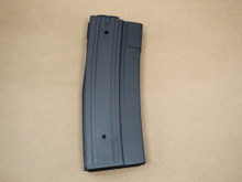 Side of magazine. The slight curve in the body visible, this curve corrects for the taper of the cartridge.
