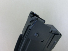 Note the wider taller rear lock up point. This surface contacts a bearing surface inside of the shotgun receiver to hold the magazines forward.