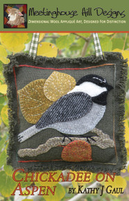 Chester, the Chickadee resting on a branch amongst the changing leaves of our aspen tree!