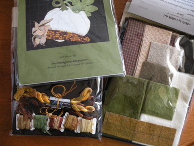 The complete kit with pattern, all the felted wools including the background, all the hand-dyed variegated threads including the corn kernels, freezer paper and the cotton pillow backing fabric.