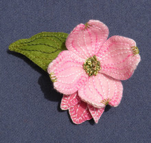 "A dimensional dogwood blossom!  Wire adds ""shape-ability"" to these petals.  Makes a great pin, name tag or taper topper""."