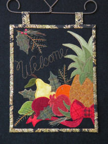 """Finished size 8 1/2"""" x 10 1/2"""" shown on a wire hanger. This piece also fits perfectly on an Ackfeld wire stand display!"""