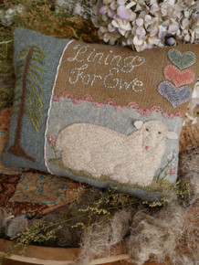 Our little pillow has found a home, gracing a wooden bowl!