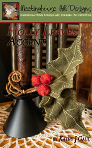 "A pair of wired holly leaves with wool berries are shapeable and look charming on a candle stand, as a package decoration or ornament!  Pair with our 9"" timer tapers and candle stands.  As shown the leaves measure about 5"" x 7"" as a pair."