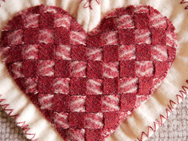 """This kit makes  this one block, finished at 10"""" x 10"""" (a little larger than the size of the block within the quilt.)  This woven heart is  easy to make with our detailed instructions!  And, it could be a great bowl filler or ring bearer's pillow for a wedding!  Just add a ribbon to attach the rings!"""