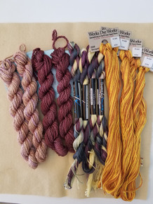 KIT includes well felted pale yellow wool, and a total of 13 skeins of thread to complete this cob.