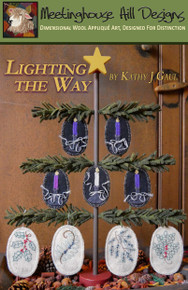 "Lighting the Way... for Christmas!  Our new Advent ornament collection, displayed on our Lighting the Way TREE (sold separately).  Ornaments are 2"" x 3"" and  2 1/2"" x 3 3/4"", appliqued and embroidered."