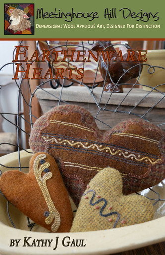 Antique Inspirations... Earthenware Hearts.  Our trio of pottery inspired hearts with simple and quick wool applique and embroidery designs.  3 sizes, complete instructions and full scale patterns for each.