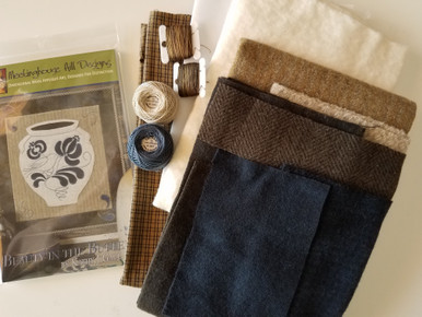 Complete KIT includes a pattern, all the felted wools (slip trail designs are hand dyed wools), all the hand dyed Valdani threads, cotton backing/binding (small plaid) and cotton batting (for completing as a wall hanging).