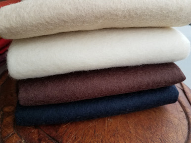 """100% American-made Wool FELT - non woven fabrics.  4 fat quarters, each sized 18"""" x 18"""".  (A yard of wool felt measures 36"""" x 36"""".)  NEUTRALS - Black, Brown, Oatmeal and Creamy White."""