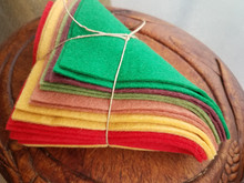 """This is a bundle of 12, 6"""" squares of American-made 100% wool felt.  These are non-woven fabrics.  There are 2 squares in each of 6 colors!"""