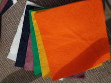 """This is a bundle of 12, 6"""" squares of American-made 100% wool felt.  These are non-woven fabrics.  There are 2 squares in each of 6 colors! This is a bundle of more traditionally BRIGHT colors, used for our Happy Fall pattern!"""