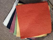 """This is a bundle of 12, 6"""" squares of American-made 100% wool felt.  These are non-woven fabrics.  There are 2 squares in each of 6 colors!  These are the PRIMITIVE colors used in the cover art of our Happy Fall pattern!   There is also a more traditional, bright combination!"""
