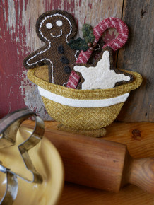 """Traditions of baking with my Auntie Von, who also taught me to sew, are the memories that came to life when I created this design.  Honored to be featured for the first time in Early American Life magazine with a wool applique design for their readers!  Each cookie, candy and yellowware bowl can be displayed separately, or in combination as displayed.   This kit includes all the felted wools and all the hand dyed """"The Gentle Art-Wool Threads"""" for stitching.  Christmas 2021 issue of Early American Life magazine is required for pattern and instructions."""