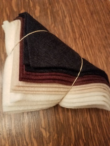 """This is a bundle of 12, 6"""" squares of American-made 100% wool felt.  These are non-woven fabrics.  There are 3 squares in each 4 colors: vintage black, brown, oatmeal and natural.  Perfect for our """"Happy Fall"""" design!"""