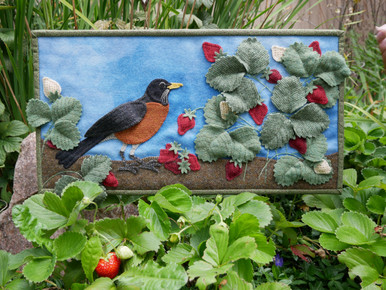 Our new pattern cover photo, taken outside in our tiny strawberry patch.