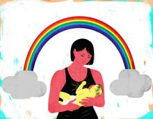 Mother breastfeeding rainbow baby